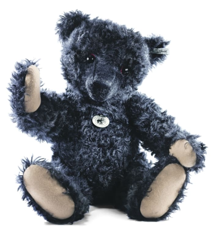 A replica of the famous black Titanic Mourning Teddy Bear by Steiff.