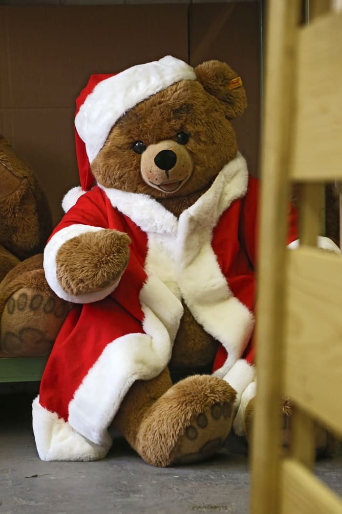 A teddy bear wears a Santa Claus costume at the Steiff stuffed toy factory in 2012. Teddy bears are among the most popular children's toys.