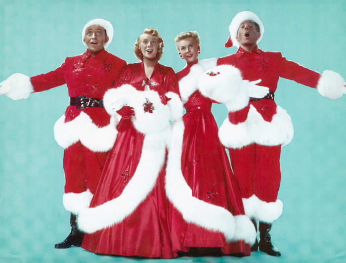 """Bing Crosby, Rosemary Clooney, Vera-Ellen and Danny Kaye, dressed in festive finery, sing """"White Christmas"""" and all is right with the world."""