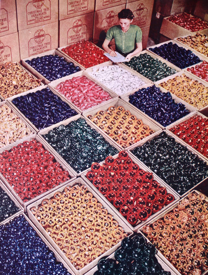 An factory worker is surrounded by Shiny Brites.