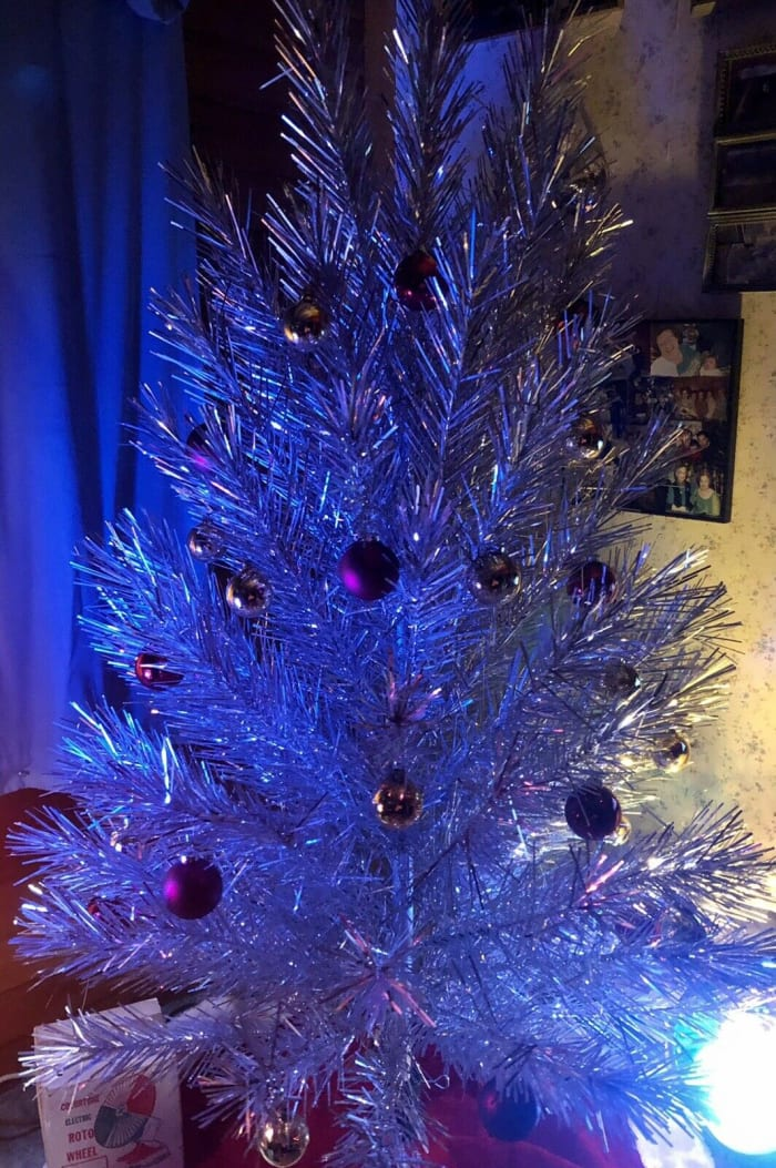 The 94-branch vintage 6-foot Evergleam lit up in purple.