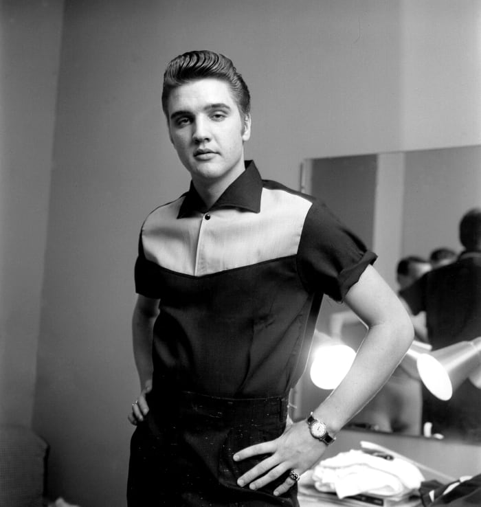Looking clean cut, but with an edge, Elvis wears his signature style backstage at the Milton Berle Show in Burbank, California, on June 4, 1956.
