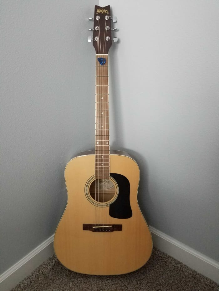 At the ready, my trusty -- and unplayed -- Washburn guitar bought at Dave's Guitar Shop in La Crosse, Wisconsin.