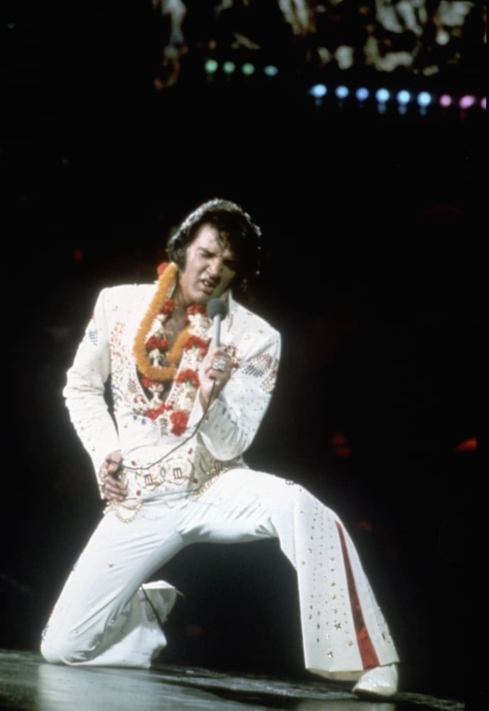This is the image most people associate Elvis with: the iconic white jumpsuit. Here he performs onstage at the International Convention Center in Honolulu, Hawaii, on January 14, 1973.