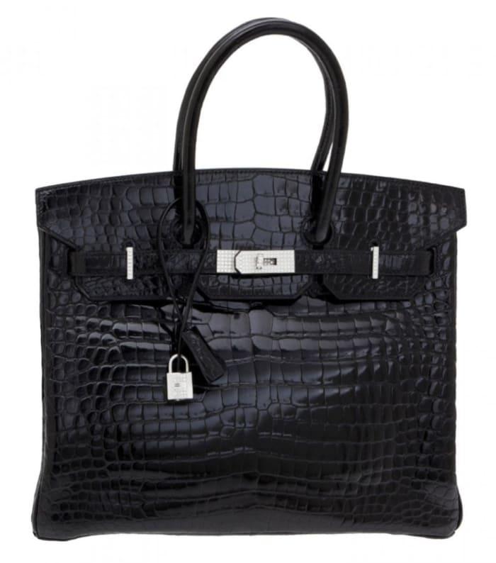 Hermès shiny black crocodile, diamond and white gold Birkin 35 handbag. Sold by Christie's through LiveAuctioneers for $287,500.