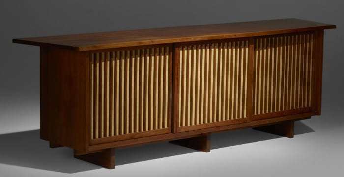 George Nakashima, triple-sliding-door cabinet, American black walnut and pandanus cloth, 1967. Sold by Rago Auctions through LiveAuctioneers for $45,500.