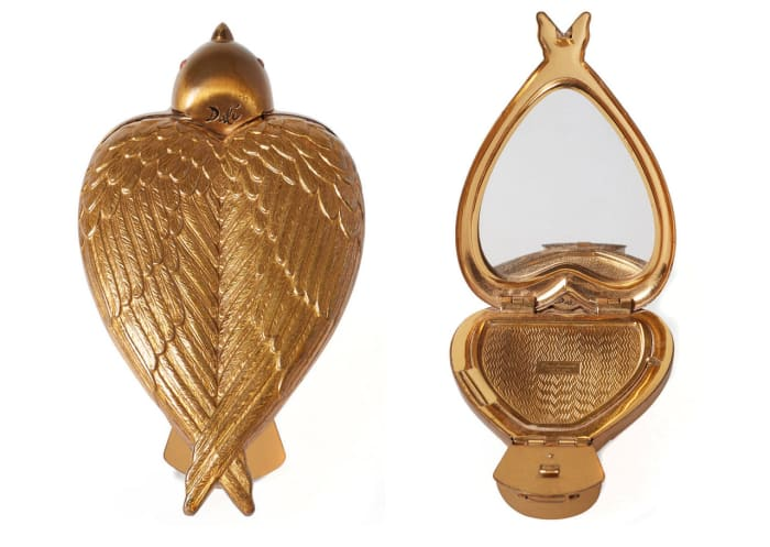 """This """"Bird-in-Hand""""  compact by Salvador Dali,  circa 1950, is one of the  museum's prized artifacts.  These compacts were valued by """"Antiques Roadshow"""" in 2019 for $3,000-$4,000."""
