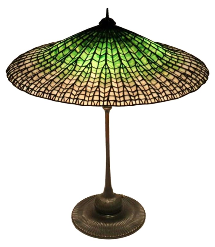 """Tiffany Studios' table lamp with """"Lotus"""" shade. Sold by Clarke Auction through LiveAuctioneers for $150,000."""